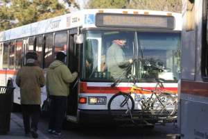 people getting on city bus debt broke