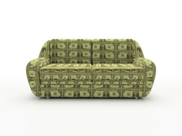 Sofa with dollars isolated on white background