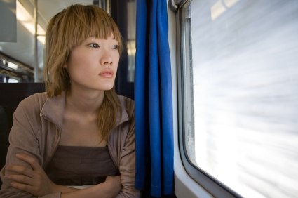 Worried-woman-on-train