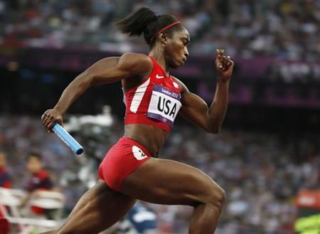 Tianna Madison of the U.S. competes in her women's 4x100m relay heat during the London 2012 Olympic Games at the Olympic Stadium
