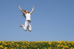happy-woman-jumping in field